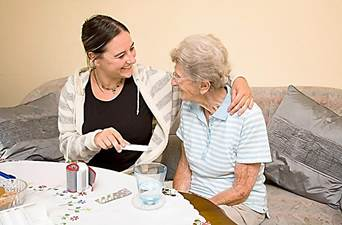 younger woman assisting an older woman